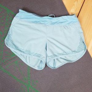 Athleta light blue, laser cut edged running shorts
